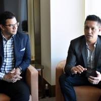 Michael Aragon (right), Twitch's senior vice president of content, speaks during a recent interview in Tokyo as Raiford Cockfield III, head of Twitch's Tokyo office, looks on. | SATOKO KAWASAKI