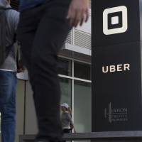Uber Technologies Inc. is reportedly prepared to make concessions to restore its revoked taxi license in London after the ride service said it will fight its suspension order in court. | BLOOMBERG