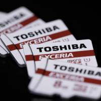 Western Digital Corp. has taken legal measures against a new investment by Toshiba Corp., whose memory cards are pictured, in a facility at their joint microchip plant in Mie Prefecture. | BLOOMBERG