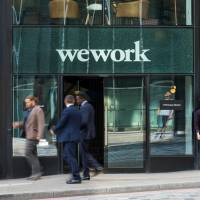 Pedestrians pass outside a shared office space operated by WeWork Cos Inc. in London last month. | BLOOMBERG
