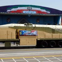 Defying U.S., Iran unveils new missile during parade