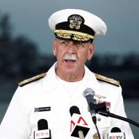 Adm. Scott Swift, head of the U.S. Pacific Fleet, speaks at a news conference near the damaged guided-missile destroyer USS John S . McCain at Changi Naval Base in Singapore on Aug. 22. | REUTERS