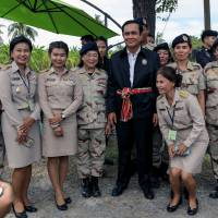 Thai Prime Minister Prayuth Chan-ocha poses for a photo with local government officers at a farming school in Thailand's Suphan Buri province on Sept. 18.   REUTERS