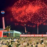 North Koreans celebrate Sunday's test of a hydrogen bomb for an ICBM at Kim Il Sung Square in Pyongyang on Wednesday. | KCNA / VIA KNS  / VIA AFP-JIJI