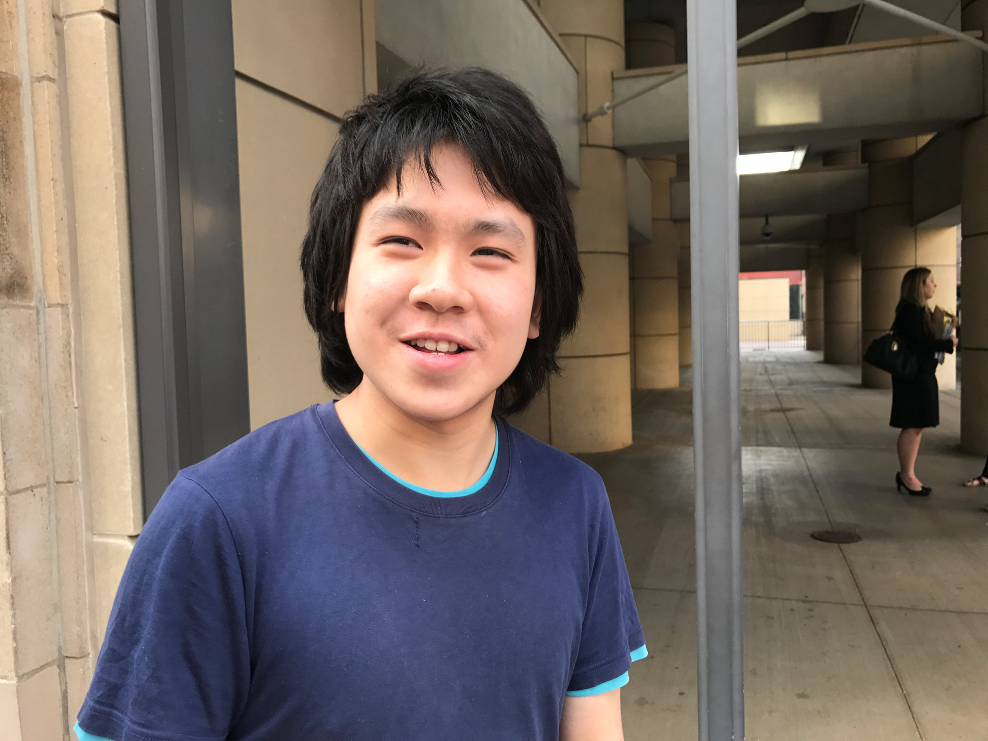 Amos Yee stands outside the United Sates Citizenship and Immigration Services offices after his release from detention in Chicago on Tuesday. | REUTERS