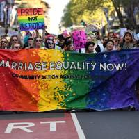 Thousands rally in support of Australia gay marriage ballot as polls narrow