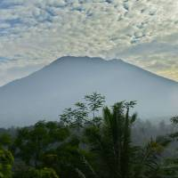 Mount Agung is seen from Karangasem in the eastern part of the Indonesian resort island of Bali on Sunday. Authorities have raised alert levels for Agung after hundreds of small tremors stoked fears it could erupt for the first time in more than 50 years. | AFP-JIJI
