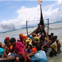 Bangladesh offers land to shelter thousands of Rohingya fleeing Myanmar as camps burst at seams