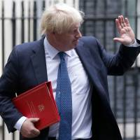 Britain's Foreign Secretary Boris Johnson leaves No. 10 Downing Street in central London on Friday. | AFP-JIJI