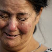Frances Breaux cries as she talks about her fears for two close friends who live near the Arkema Inc. chemical plant Thursday in Crosby, Texas. Breaux said her close friends, an elderly couple who live close to the plant, have not been heard from Thursday. | AP