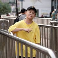 Li Yijie, a member of the Sichuan-based rap group Tianfu Shibian, poses for a photo ahead of an interview in Beijing on Aug. 10.   REUTERS