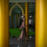 A Chinese Muslim woman arrives for prayers at a mosque in Shanghai on Friday. | AFP-JIJI