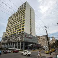 The Hotel Capri in Havana, is photographed Tuesday. New details about a string of mysterious 'health attacks' on U.S. diplomats in Cuba indicate the incidents were narrowly confined within specific rooms or parts of rooms. Aside from their homes, officials said Americans were attacked in at least one hotel, the recently renovated Hotel Capri, steps from the Malecon, Havana's iconic, waterside promenade. | AP