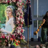 Australian's woman's family hoping for open process in charging decision over shooting by police officer