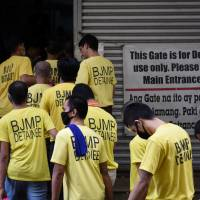 Detainees enter a government building to attend a court hearing at a Regional Trial court in Quezon City, Metro Manila, in June. | REUTERS