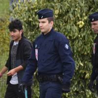 557 migrants 'living in mud' in makeshift camp near Dunkirk evacuated by French police