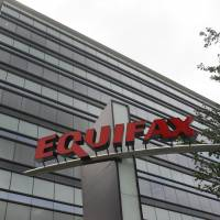 The Atlanta-based credit-monitoring company Equifax says 'criminals' exploited a U.S. website application to access data from about 143 million Americans, Britons and Canadians. | AP
