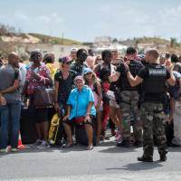 Military planes evacuate hurricane-hit tourists to Europe amid criticism of poor preparations