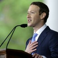 Facebook CEO Mark Zuckerberg delivers the commencement address at Harvard University in Cambridge, Massachusetts, on May 25. The social network is under fire for providing little transparency about political ads. | AP