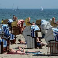 People sunbathe at the Baltic Sea beach of Travemuende in this file photo. | REUTERS