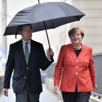 Merkel expected to win German election in which voters are torn between stability, change