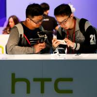 Google buys part of HTC for $1.1 billion in bid to compete with Apple and Amazon on devices