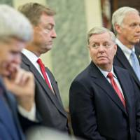 Sens. (from right) Ron Johnson, a Republican from Wisconsin; Lindsey Graham, a Republican from South Carolina; Dean Heller, a Republican from Nevada; and Bill Cassidy, a Republican from Louisiana, hold a news conference to reform health care on Capitol Hill in Washington on Wednesday. The Graham-Cassidy-Heller-Johnson (GCHJ) proposal repeals the structure of Obamacare and replaces it with a block grant given annually to states to help individuals pay for health care.   BLOOMBERG