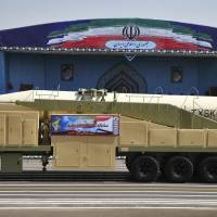 Iran's Khoramshahr missile is displayed by the Revolutionary Guard during a military parade marking the 37th anniversary of Iraq's 1980 invasion of Iran, in front of the shrine of late revolutionary founder Ayatollah Khomeini, just outside Tehran, on Friday. | AP