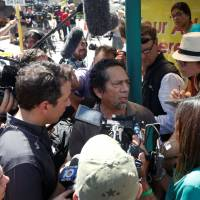 Guillermo Nunez speaks to the media regarding the condition of a Rehabilitation Center at Hollywood Hills patient, Saga Garcia, the mother of his sister-in-law, in front of the Center in Hollywood, north of Miami, Wednesday. | REUTERS
