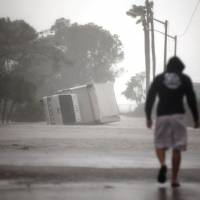 Late weakening dampens Irma's power after its record-setting, destructive approach