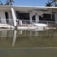 A condo building destroyed by Hurricane Irma that had been three-stories tall before collapsing in the storm, is seen in Islamorada, in the Florida Keys, Tuesday.   AFP-JIJI