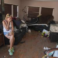 Patty Purdo surveys the damage caused to her trailer home from Hurricane Irma at the Seabreeze Trailer Park in Islamorada, in the Florida Keys, Tuesday.   AFP-JIJI