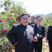 This undated picture released from North Korea's official Korean Central News Agency (KCNA) on Thursday shows North Korean leader Kim Jong Un visiting a fruit farm in South Hwanghae province in North Korea. | AFP PHOTO / KCNA VIS KNS AND AFP PHOTO / VIA AFP-JIJI