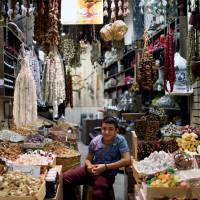 A Kurdish boy sells nuts and sweets at the market in Irbil's old city on Wednesday. | REUTERS
