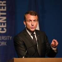 France's President Emmanuel Macron gives a speech at the Graduate Center of City University in New York during a ceremony to lauch a French-English bilingual fund for education on Wednesday.   AFP-JIJI