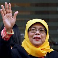 Former speaker of Singapore's parliament, Halimah Yacob, arrives at the Elections Department on Monday. | REUTERS
