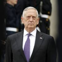 Defense Secretary Jim Mattis stands at the Pentagon in Washington last month. The U.S. has seen no need to shoot down North Korean missiles test-fired in Japan's direction, but a future missile launch that threatens U.S. or Japanese territory will 'elicit a different response from us,' Mattis said Monday. | AP