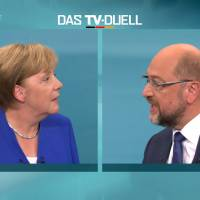 A screen shot shows the TV debate between German Chancellor Angela Merkel of the Christian Democratic Union (CDU) and her challenger, Germany's Social Democratic Party SPD candidate for chancellor Martin Schulz, in Berlin Sunday. German voters will take to the polls in a general election on Sept. 24. | MEDIENGRUPPE RTL DEUTSCHLAND (MG RTL D) / HANDOUT / VIA REUTERS