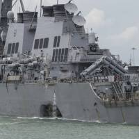 U.S. Navy fires two commanders in connection with ship collisions