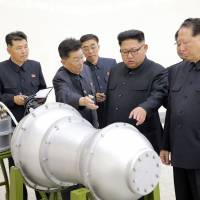 North Korean state media reported on Sept. 3 that leader Kim Jong Un had watched the loading of a hydrogen bomb onto a missile at a nuclear lab. | AFP-JIJI