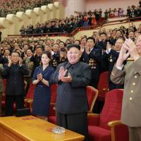 North Korean leader Kim Jong Un claps during a celebration for nuclear scientists and engineers who contributed to a hydrogen bomb test in this undated photo released Sunday. | KCNA / VIA REUTERS