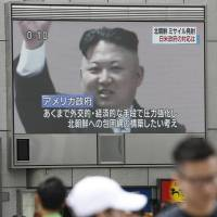 North Korean leader Kim Jong Un is seen on a large television monitor in Osaka on Friday after his nuclear-armed country launched a second missile in just over two weeks over Japan. | KYODO