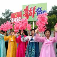Pyongyang residents greet contributors to Sunday's test of a hydrogen bomb on Wednesday. | AFP-JIJI