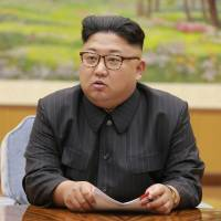 North Korean leader Kim Jong Un attends a Sept. 3 meeting of a committee of the Workers' Party of Korea about the test of an apparent hydrogen bomb. | AFP-JIJI