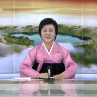 North Korean TV presenter Ri Chun Hee announces the successful launch of a new intercontinental ballistic missile in this July 4 still image taken from TV. | REUTERS