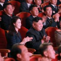 North Korean leader Kim Jong Un claps during a celebration for nuclear scientists and engineers who contributed to the country's claimed hydrogen bomb test in this undated photo released Sunday. | REUTERS