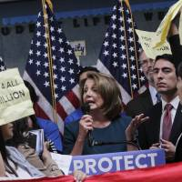 Young immigrants shout down Democratic leader Nancy Pelosi over Dreamer deal with Trump