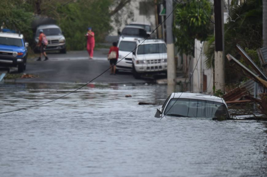 Puerto Rico flooded, in tatters, out of power in wake of Maria