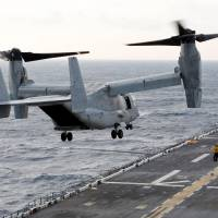An MV-22 Osprey ferrying an initial group of Marines bound for islands ravaged by Hurricane Maria takes off at sunrise from the flight deck of the USS Kearsarge as operations to assist hurricane-ravaged St. Croix and Puerto Rico begin, in the Caribbean Sea Thursday. | REUTERS