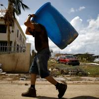 'Heat from hell' as hurricane-hit Puerto Rico copes with lack of power; Trump response hit
